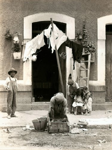 Untitled [Woman Doing Laundry in Front of Doorway with Four Children]
