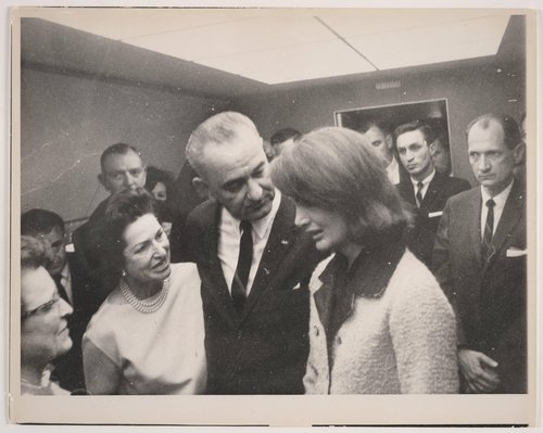 Lyndon Johnson, flanked by Lady Bird Johnson and Jacqueline Kennedy, aboard Air Force One