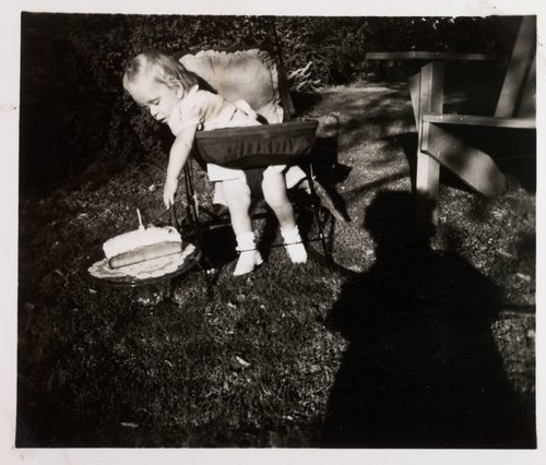 Untitled [Little girl with birthday cake]