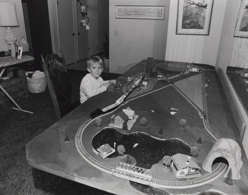 Boy with train set, from the portfolio Leisure