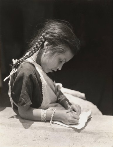 Untitled [Girl with Braids Writing]