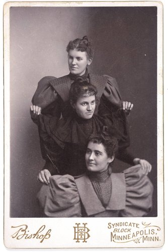 Untitled [Three women displaying their puffy sleeves]