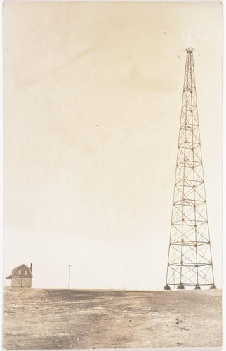 Untitled [Tower near a home]