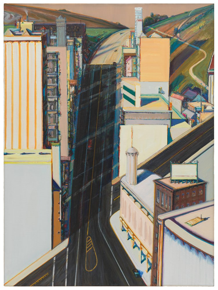 This four-foot-tall, three-foot-wide oil painting depicts a steep street running up a hill through a city. Though there are many buildings on either side of the main street, no people are visible. The main street, covered in black tarmac and thin lane markings, cuts straight up the center of the canvas, so steep that it appears almost vertical. On both sides of the street, tall buildings are lined up one behind the other, rendered in pastel oranges, blues and creams. A second street cuts across the main artery at another improbably steep angle, starting at our lower left and exiting the canvas half way up the right side. At the top of the painting, behind the last of the buildings, the setting abruptly switches to a pastoral landscape. Sloping green and brown fields fill the upper corners of the canvas, and the straight black city street becomes a tan, sunlit road that curves up between them.