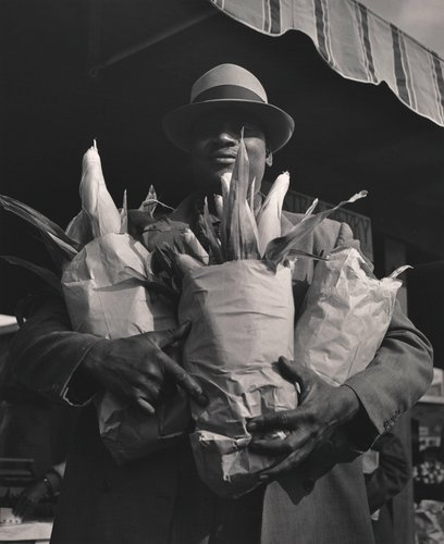 Untitled [Black man carrying three bags of corn, Farmer's Market, San Francisco]