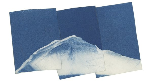 Blue photographs layered on top of each other, Sean McFarland