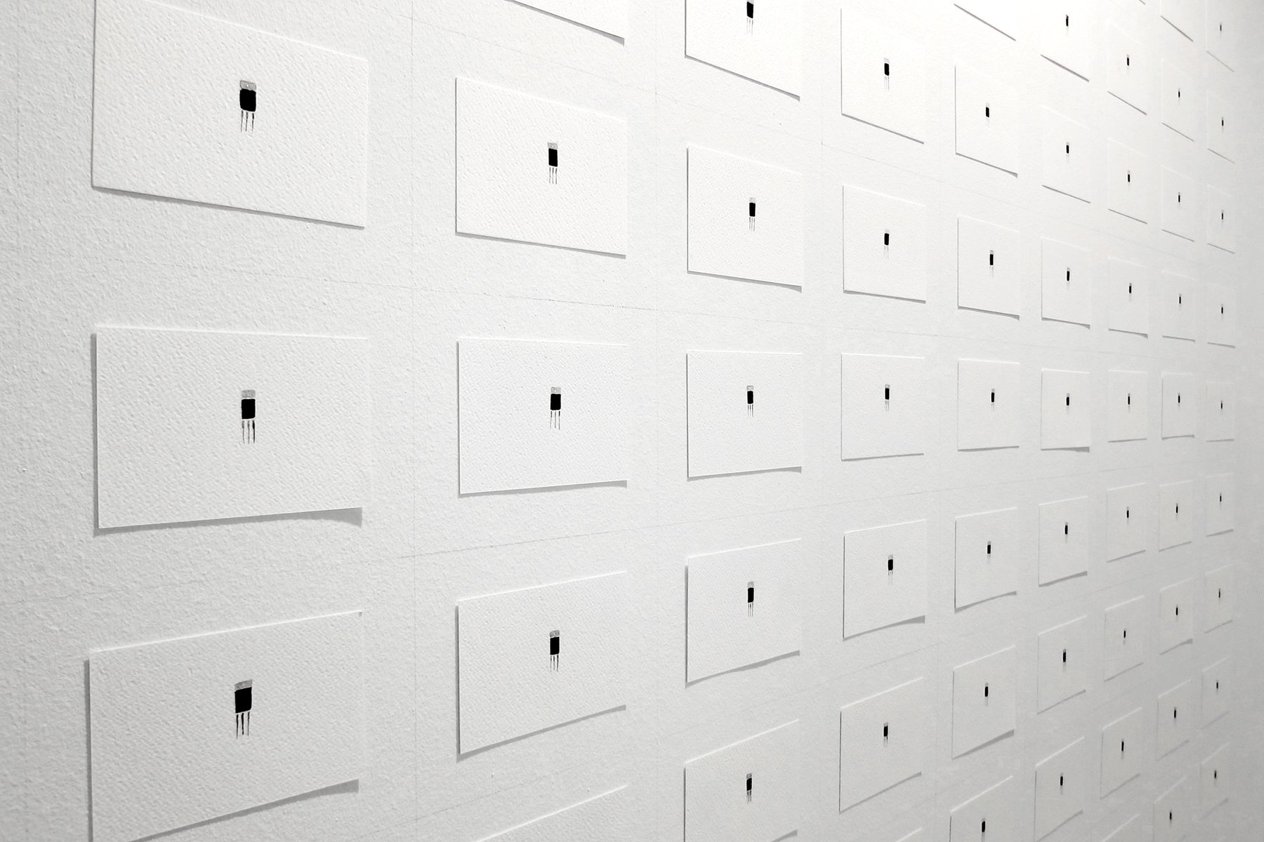 A white wall lined with small ink drawings, Munoz Soundtracks