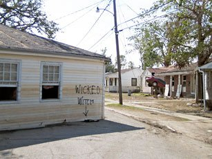 """photo of dilapidated house with spraypainted with  """"wicked witch"""""""