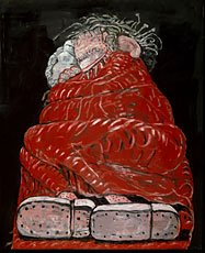 man sleeping under red blanket