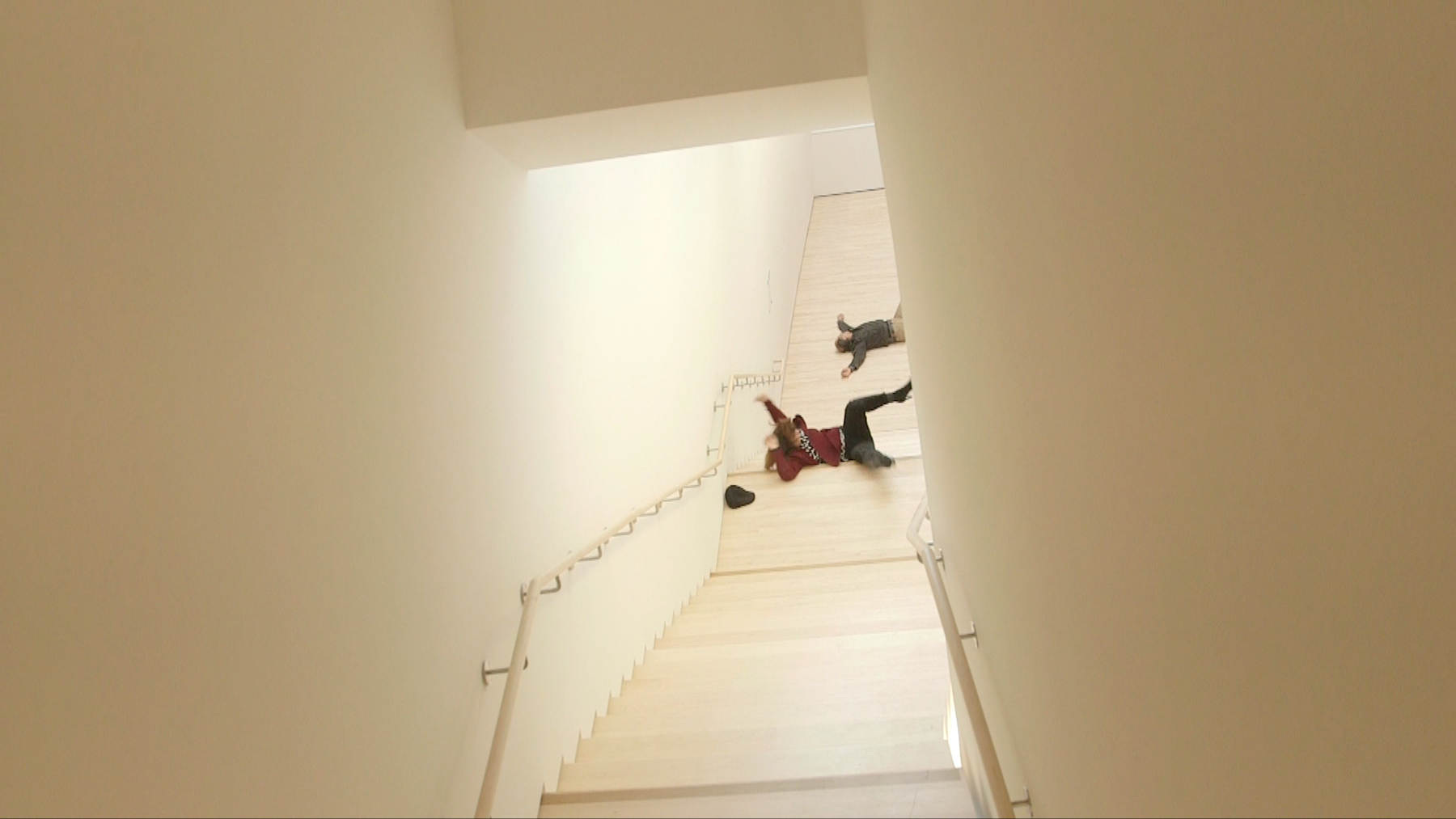 A woman falling down the stairs