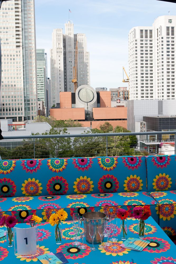 A flowered bench with the SFMOMA Botta building in the background, Gatti
