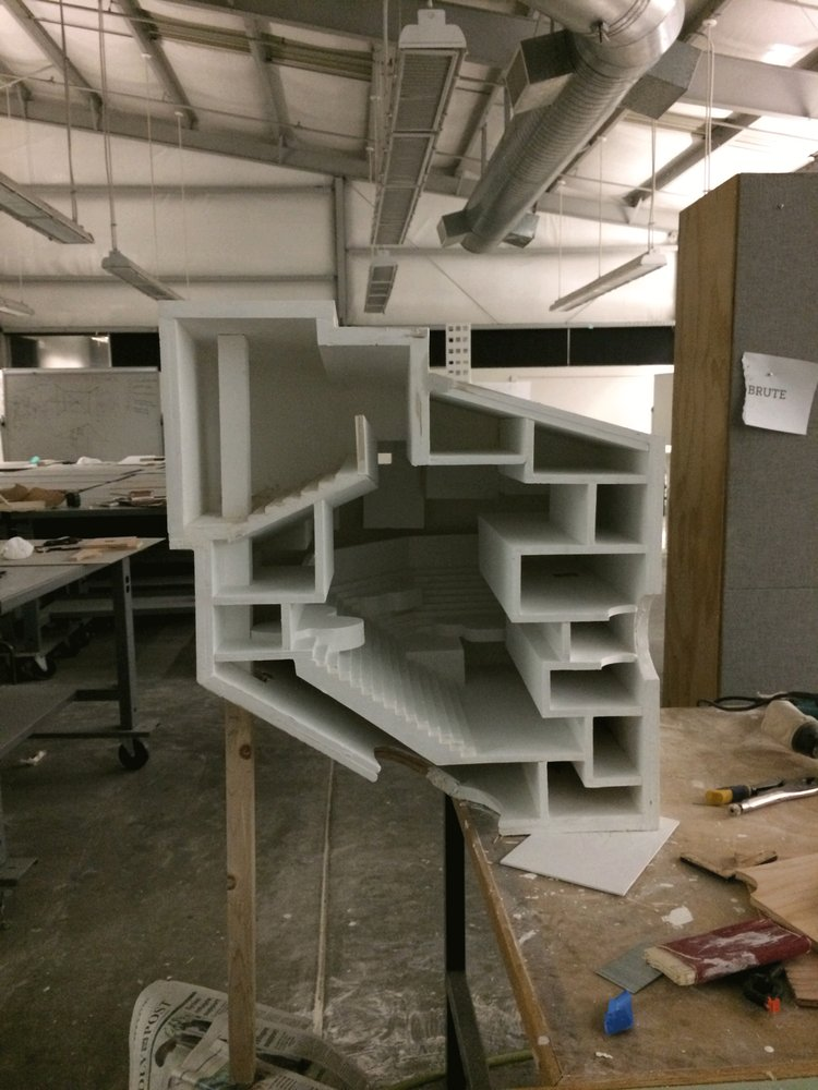 White architectural model in a workshop