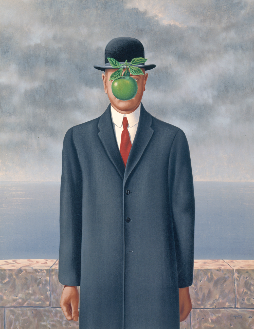 A man in a bowler hat standing in front of a cloudy sky with a green apple covering his face