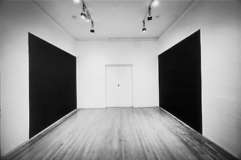 Richard Serra, two black canvases in white room with hardwood floor