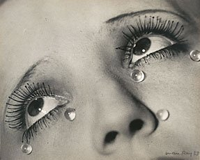 close up woman's eyes with five tear drops
