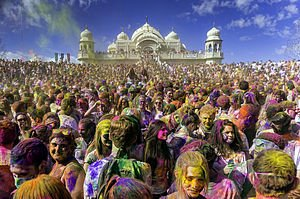A sea of faces covered in multi-colored powder