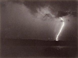 photograph of lighting striking ground