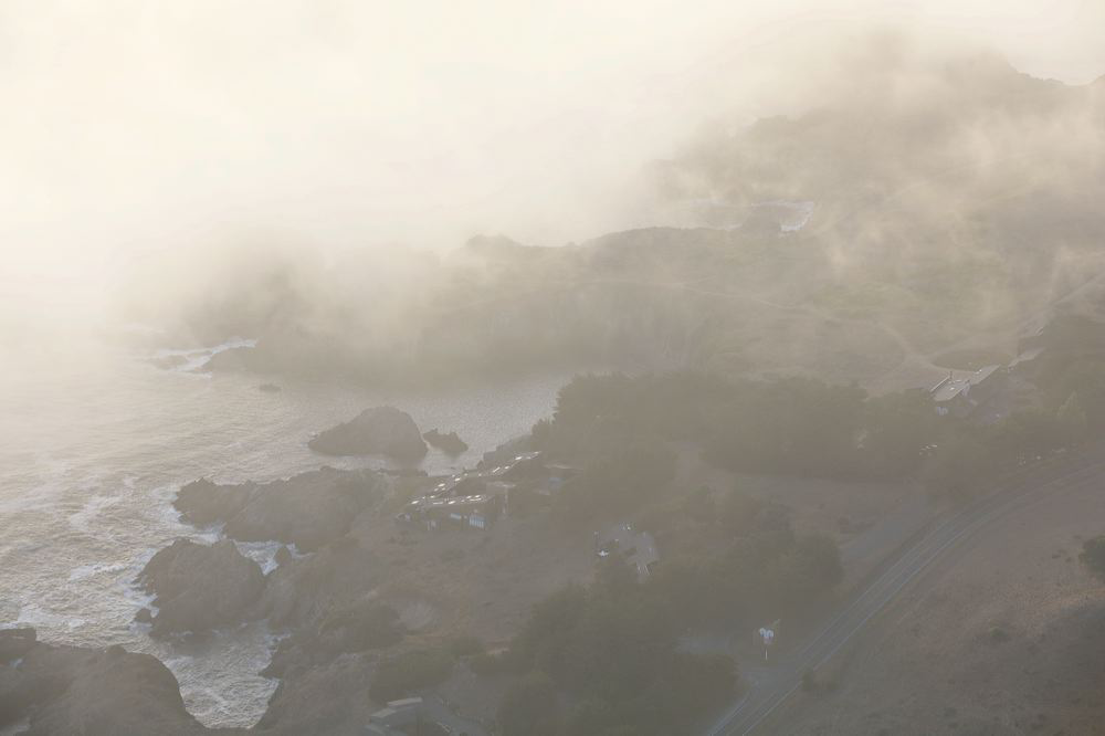 a bird's eye view of sea ranch with fog