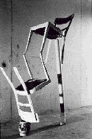 black and white photograph of two chairs balancing