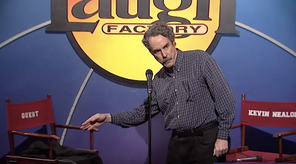 Comedian Ron Lynch performing stand-up