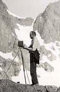 Ansel Adams with camer on mountain