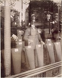 A black and white photograph of male mannequins in a window display, Eugene Atget