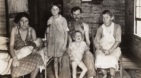 A black and white photograph of a poor Caucasian family, Walker Evans