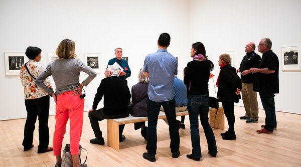 A group of people looking at art