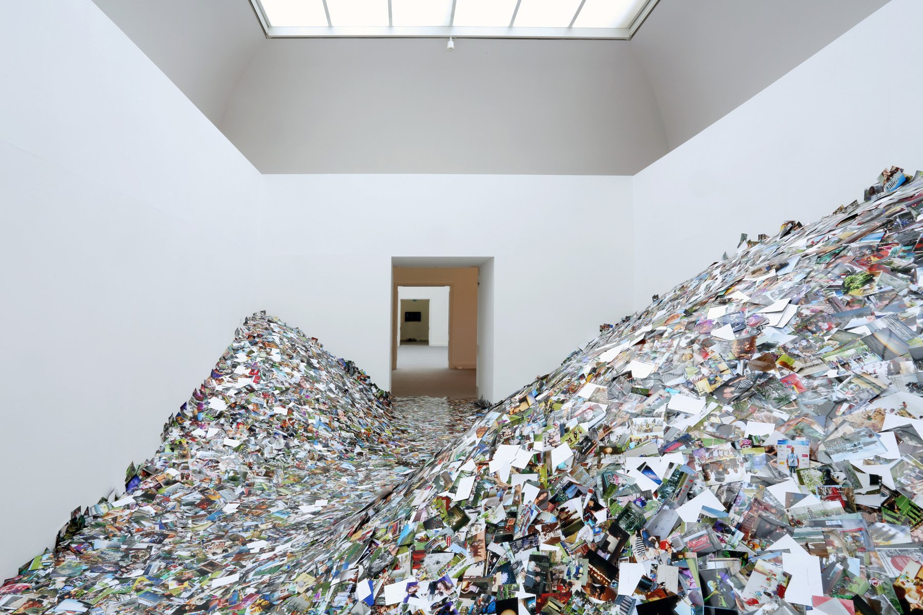 a room filled with photographs piled high