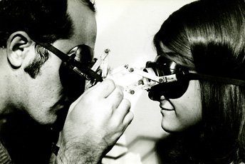 man and woman looking at each other wearing goggles