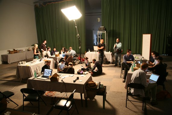 A room full of teams working on laptops