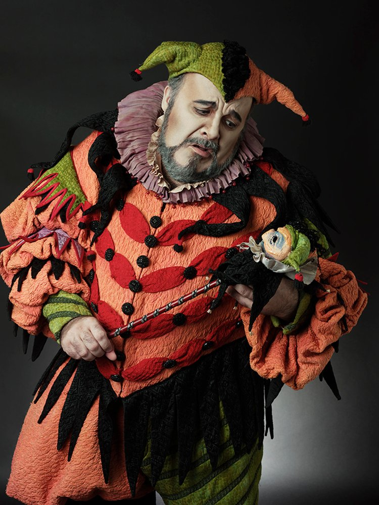 Photograph of a man dressed in a court jester costume