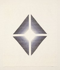 four dark geometric shapes forming diamond on paper