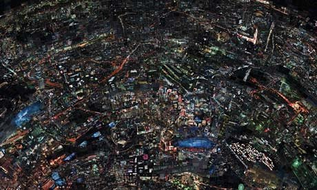 A large cityscape at night, seen from above