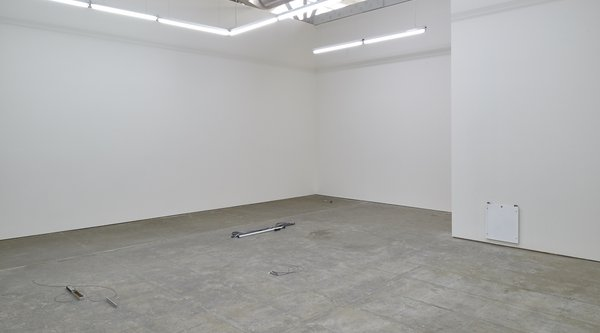 Photograph of a gallery with a stained concrete floor, K.r.m. Mooney