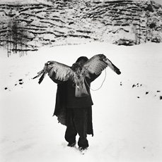 A black and white photograph of a figure from behind with wings, Li Lang