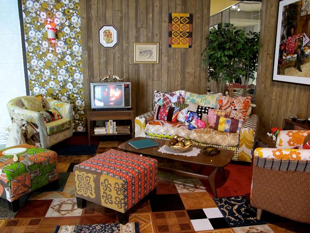 Mickalene Thomas, colorful living room with couches chairs and tv