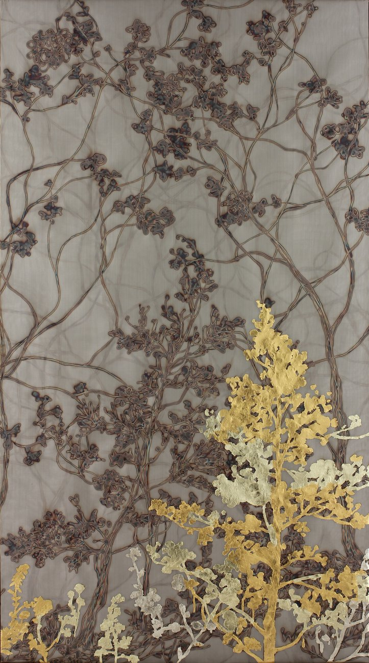 gold leaf painting with tree branch imagery on beige background