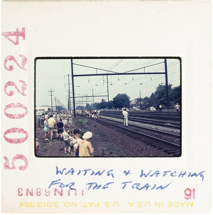 Polaroid image of train tracks with writing on it