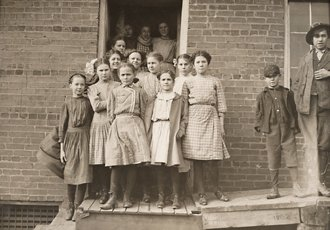 Lewis Wickes Hine, photo of school children crowded in front of door