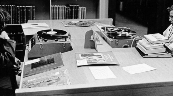 Two men listening to records at a listening station at the San Francisco Public Library