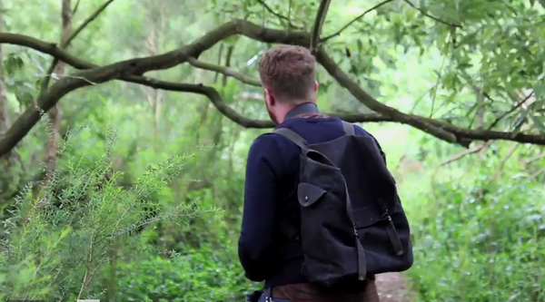 Video still of a man walking in a forest, Sean McFarland