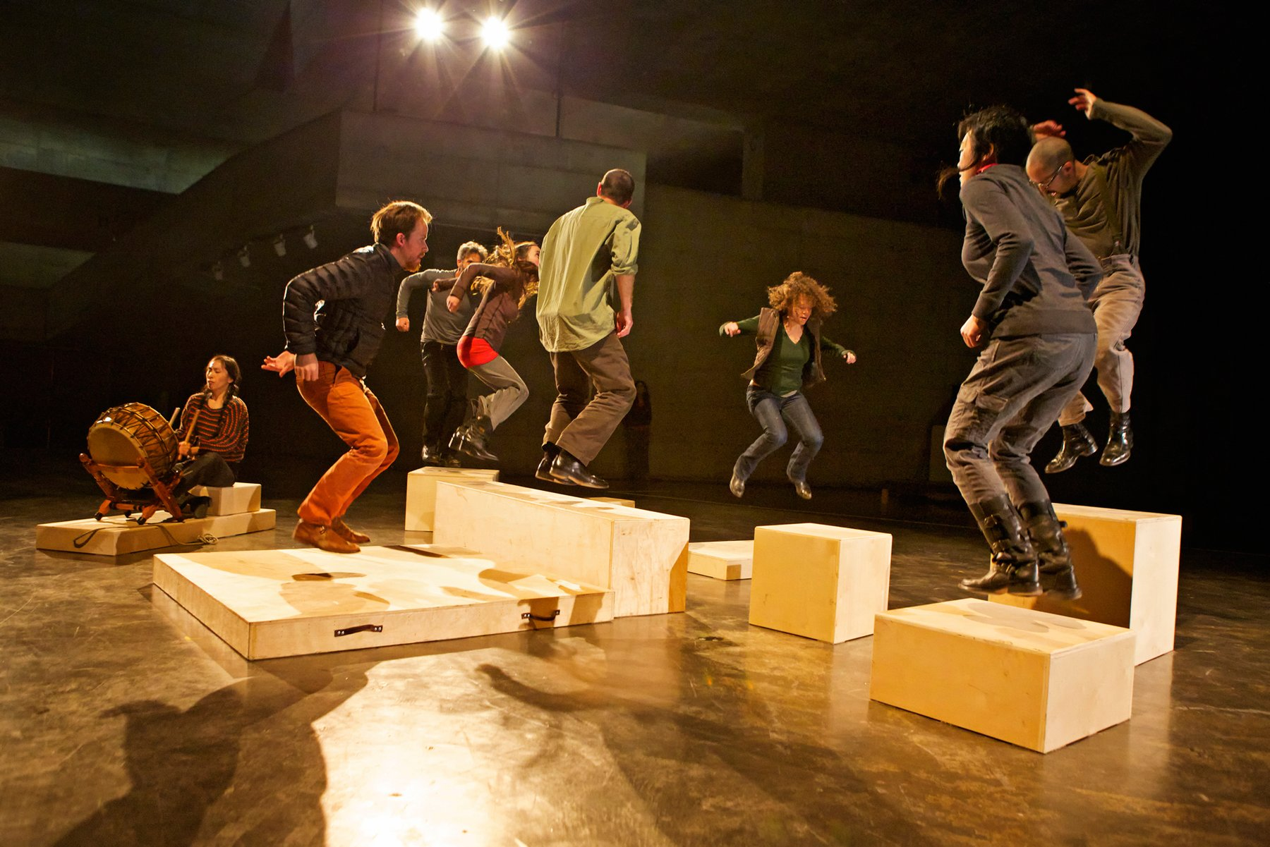 A group of figures move around wooden blocks, Anna Halpern Soundtracks