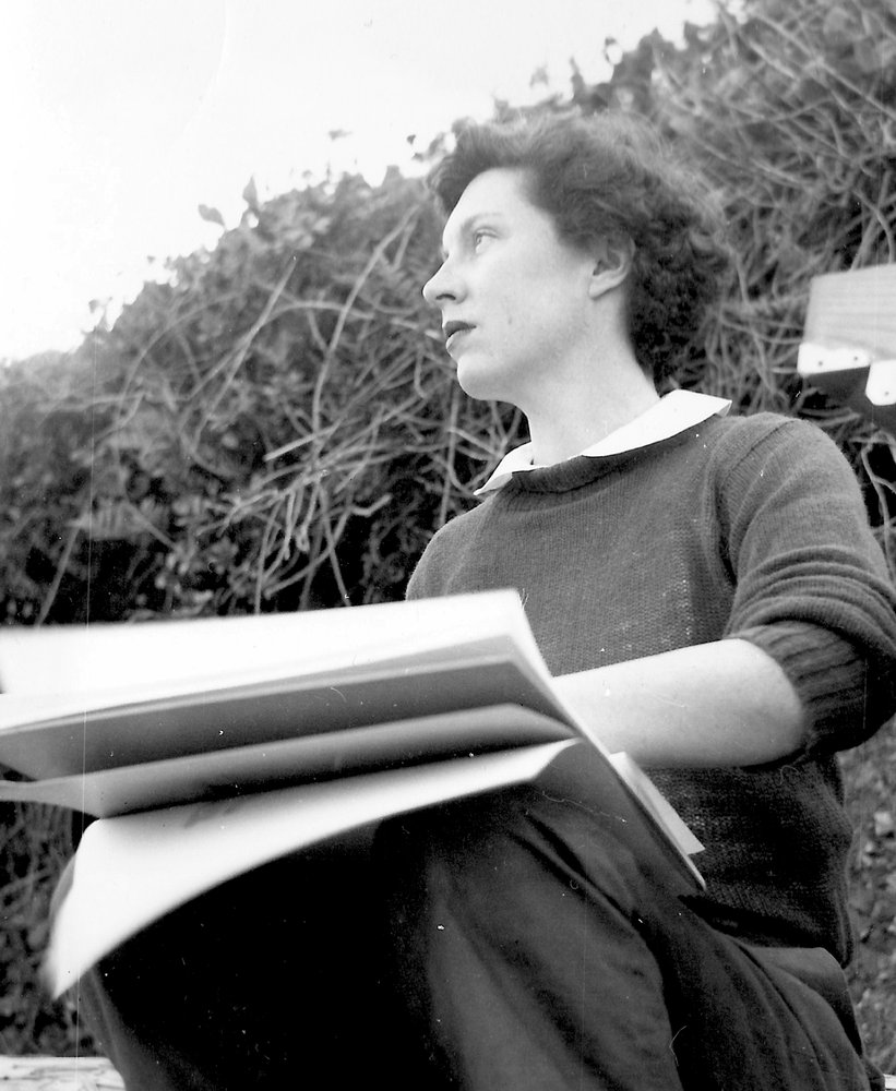 A black and white portrait of a Caucasian woman sitting outside with a sketchbook, Barbara Foster