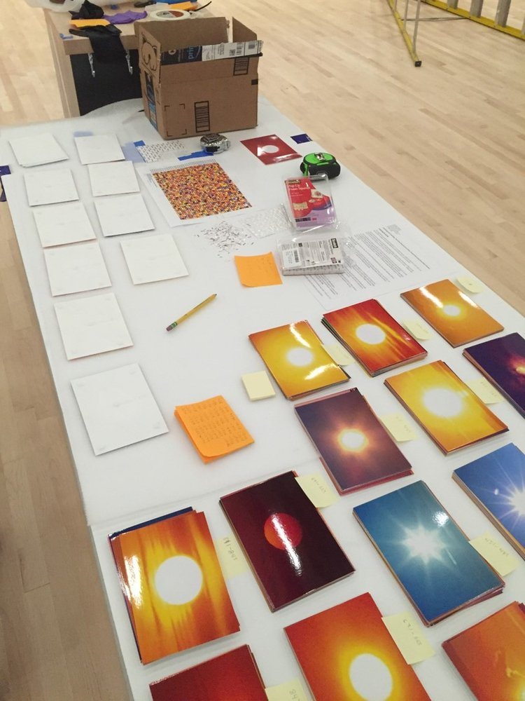 several piles of sunset pictures laid out on a table