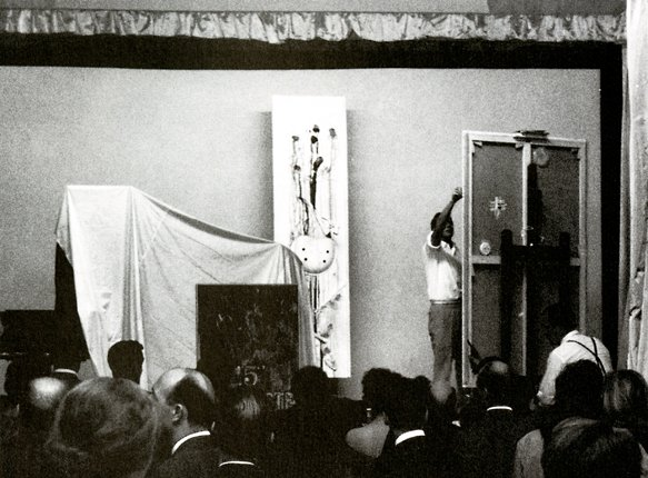 "Robert Rauschenberg working on First Time Painting onstage during ""Homage to David Tudor,"" Theâtre de l'Ambassade des États-Unis, Paris, June 20, 1961."