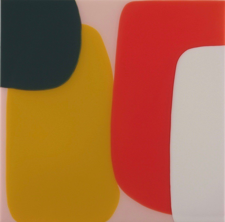 Black, yellow red and grey overlapping blobs against a pink background