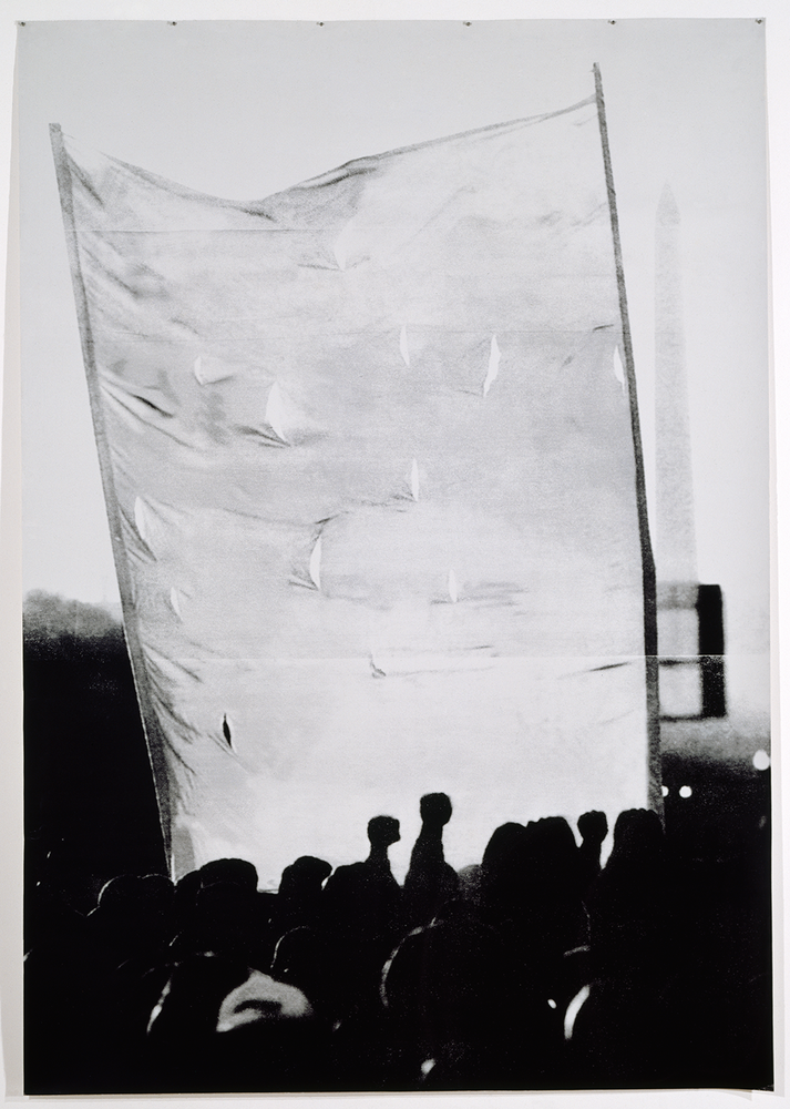 High contract image of demonstrators with fists in the air