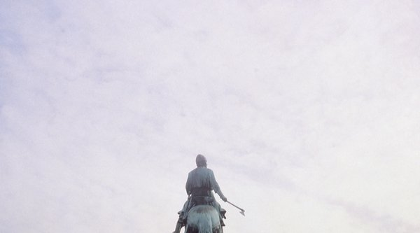 Image of the sky above a statue of a man on a horse