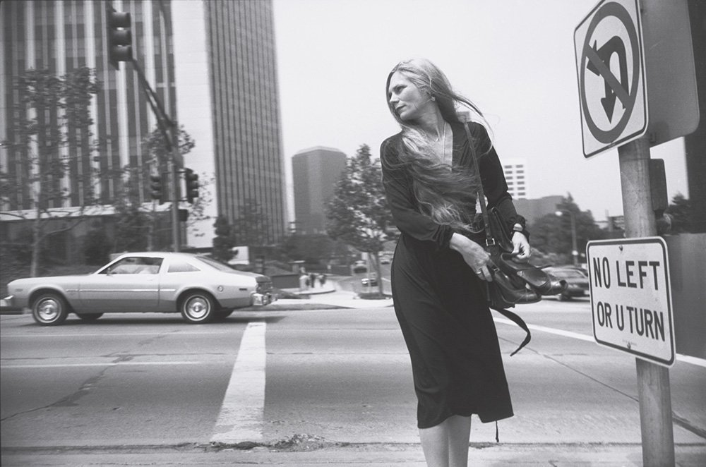 Garry Winograd, photograph of woman walking across street